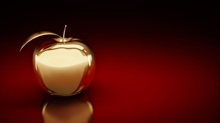 A golden apple on a red background