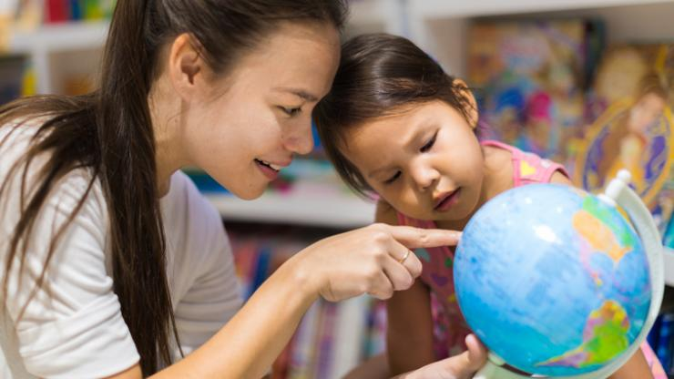 Teacher and child with globe