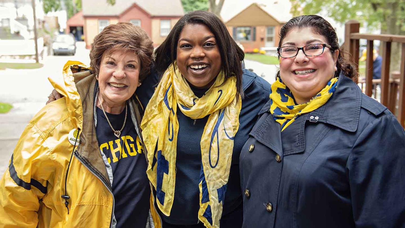 SOE tailgaters pose for a photo
